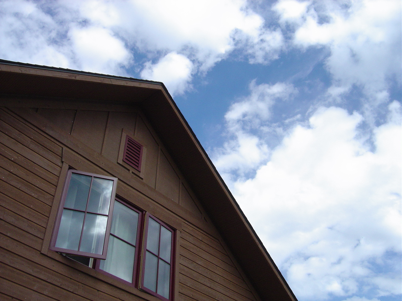 House with blue sky and clouds in background