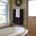 Bathtub with window above