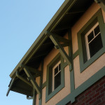 Eave of roof showing a series of wood corbels